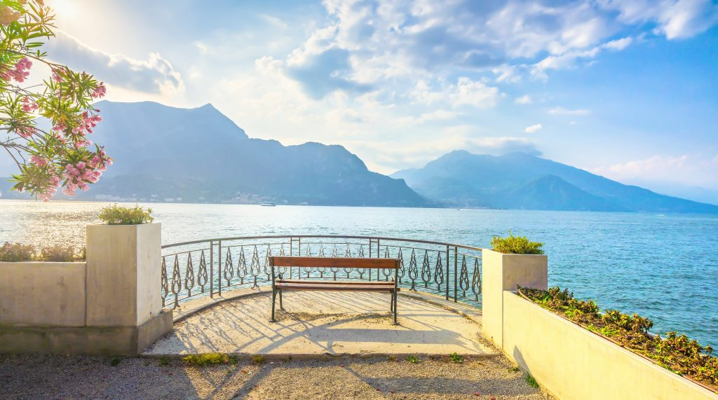 Bench On Lakefront In Como Lake Landscape. Bellagio Italy